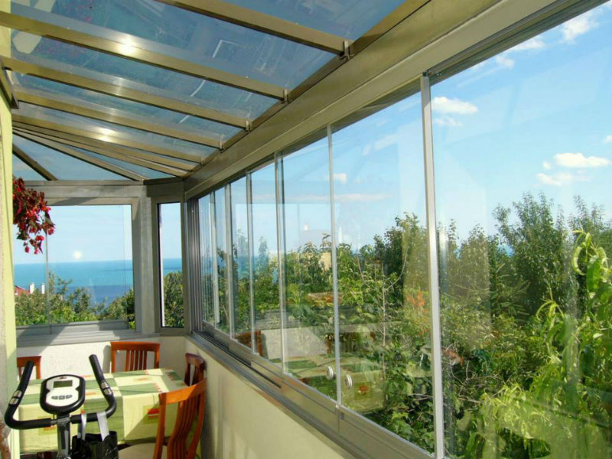 Folding glass system and polycarbonate roof